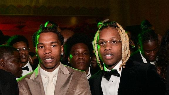 Die beiden Rapper in feiner Kluft zusammen auf einem Event.