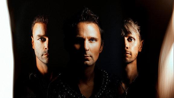 Muse, Matthew Bellamy (mi), Christopher Wolstenholme, Dominic Howard (re.)