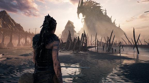 Die Heldin des Spiels steht im Wasser vor einer zerstörten Landschaft.