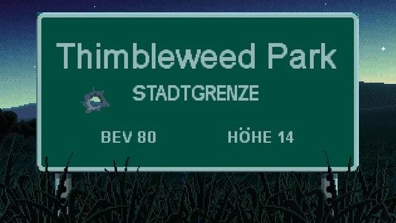 Thimble Tweed Park, das Ortsschild in grünweiß