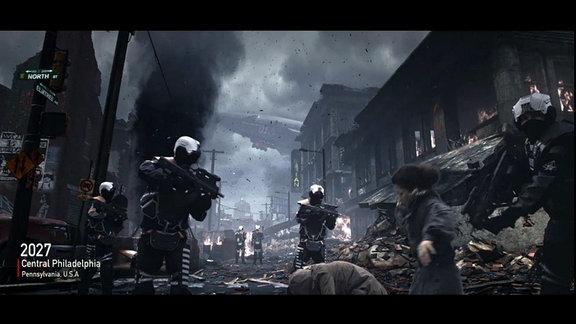 Screenshot aus dem Game 'Homefront: The Revolution'. Zu sehen ist eine Kampfszene mit Soldaten in einer zerstörten Straße Philadelphias.