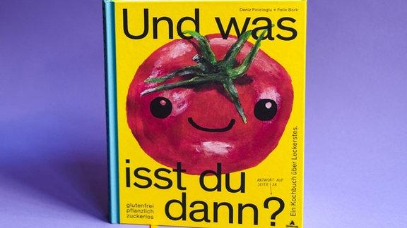 Gelbes Buchcover mit einer großen roten süß lachenden Tomate darauf.